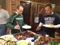 Steve Carp and Jim Lineweaver eat some breakfast at EO Outing