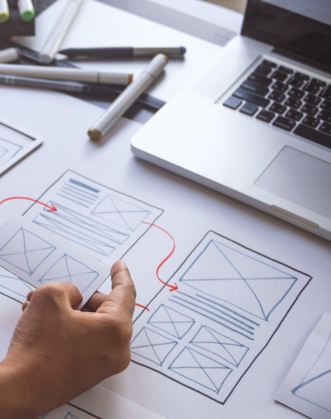 SyncShow strategist reviewing wireframes