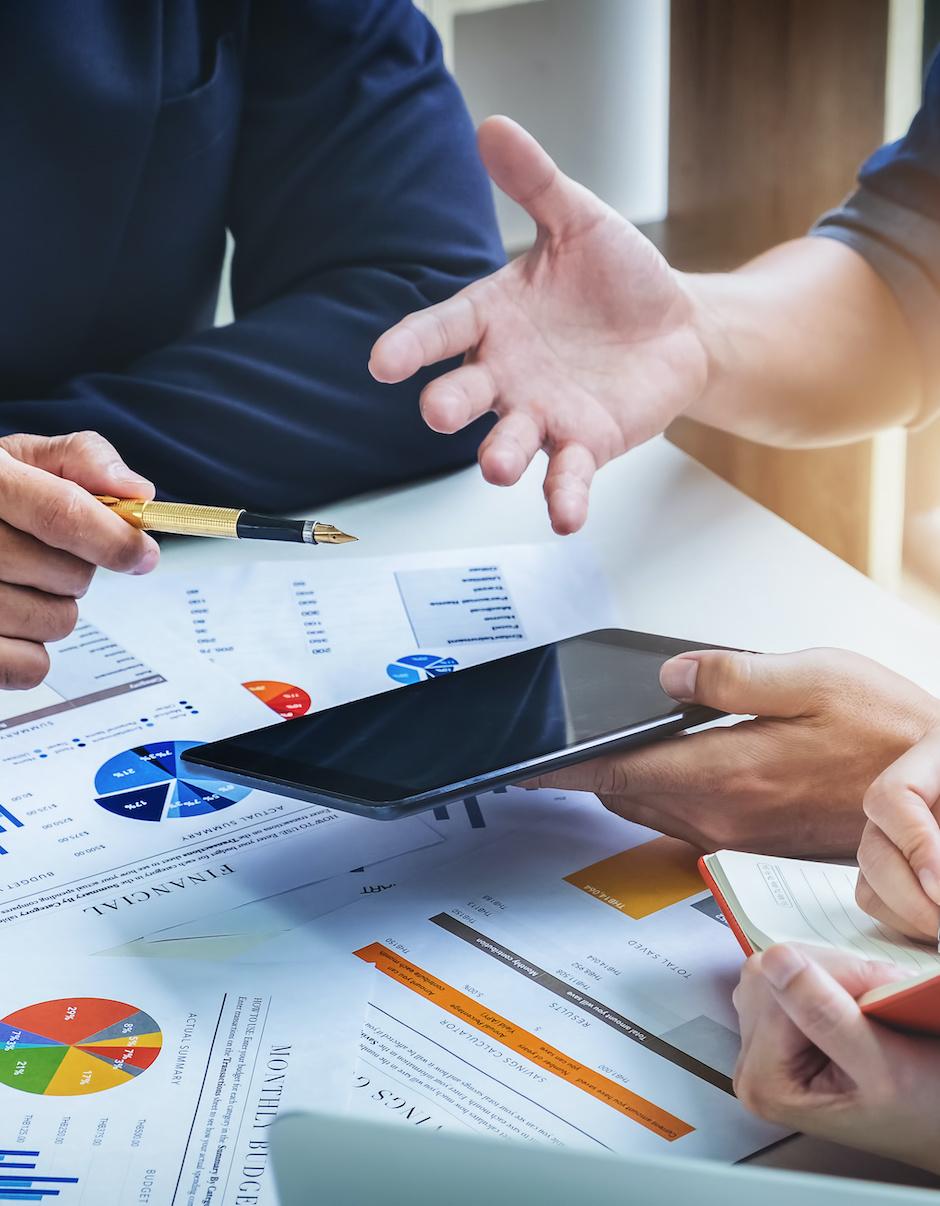 Digital marketing professionals discussing a custom lead generation plan